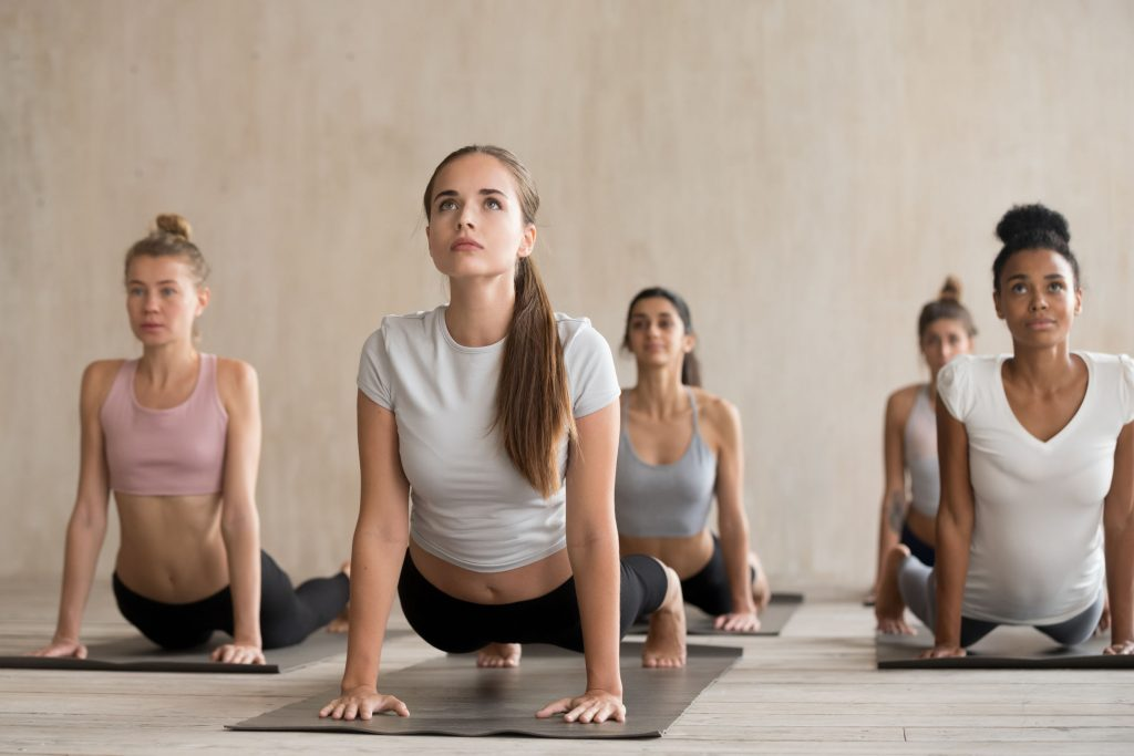 A group of women during the pilates class exercise