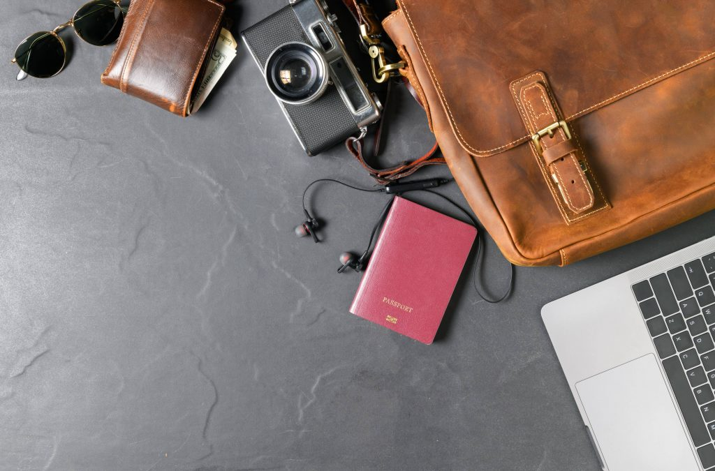 a travel bag with a laptop and a camera