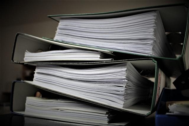 Paperwork in binders.