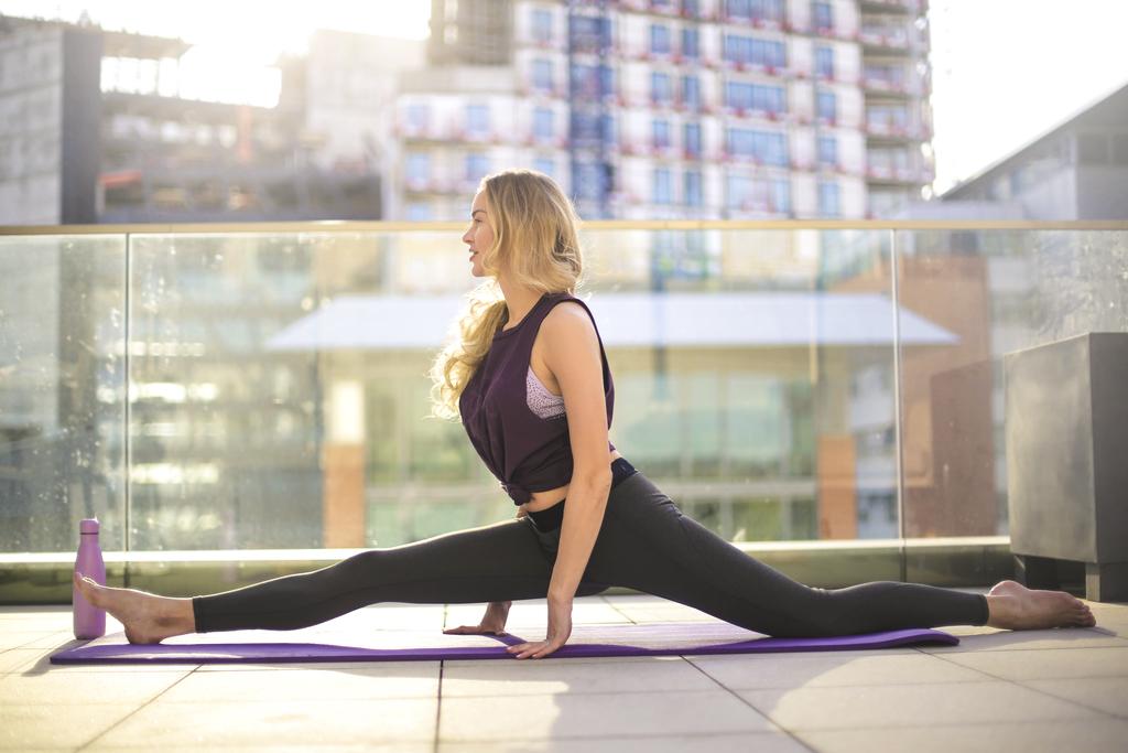 A woman doing yoga on a terrace.
