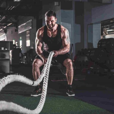 A man working out that makes you think about ways to stay motivated to exercise regularly